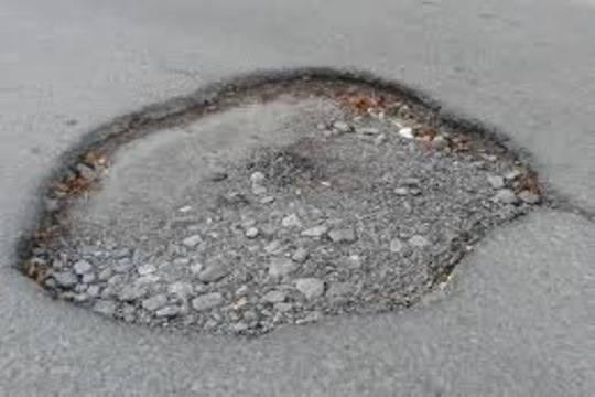 Отремонтировать разбитую дорогу вынудили администрацию Нижнего Новгорода